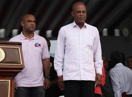 Haiti's President Martelly and PM Lamothe look out at supporters in Port-au-Prince