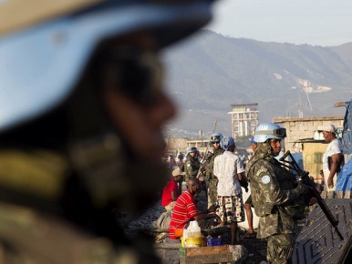Brazilian Peacekeepers stands guard in Cite Soleil on July 14, 2011.  Photo Victoria Hazou UN/MINUSTAH