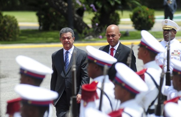 Haitian President Michel Martelly and Dominican Republic President Leonel Fernandez inspect the honour guard at the national palace in Santo Domingo