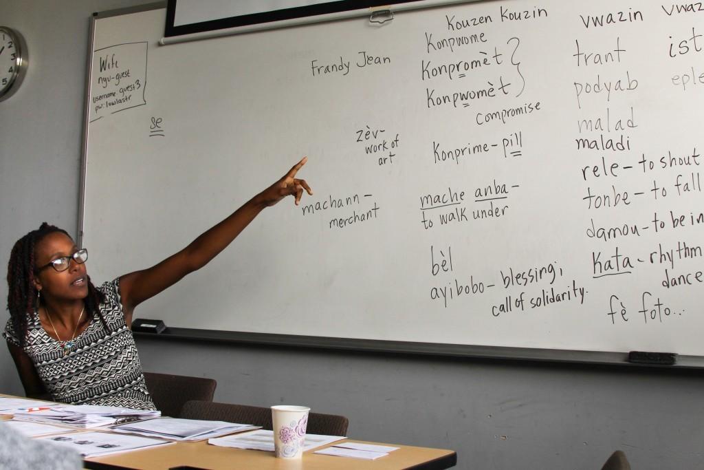Professor Wynnie  Lamour is explaining a word she has written. Photo credit: Maya Earls