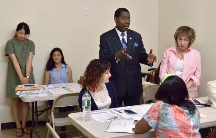 Council Member Mathieu Eugene (center) at Haiti TPS Clinic. Photo Credit: John McCarten