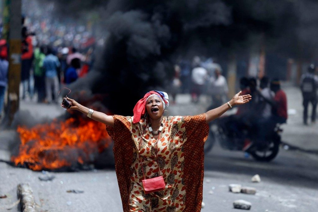 Protesters burn tires, block roads in Haiti, at least 1 dead