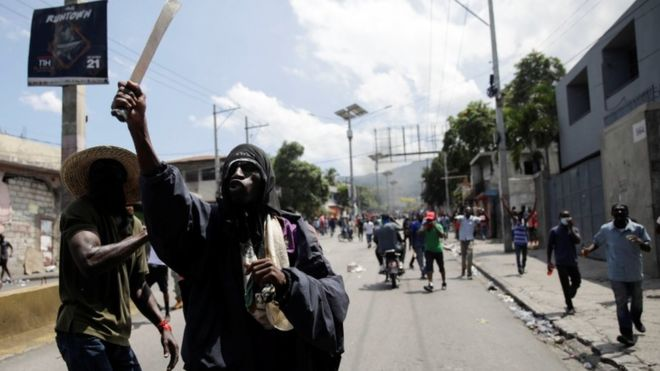 Haiti unrest: Shops and police station looted as thousands protest