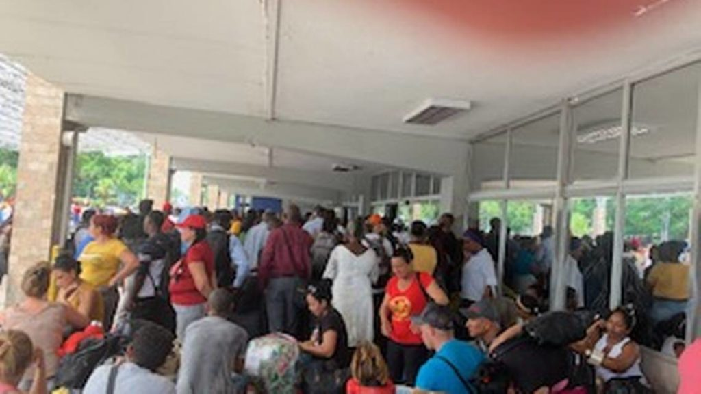 'This was supposed to be our emergency flight out of here.' Haiti closes international airport.