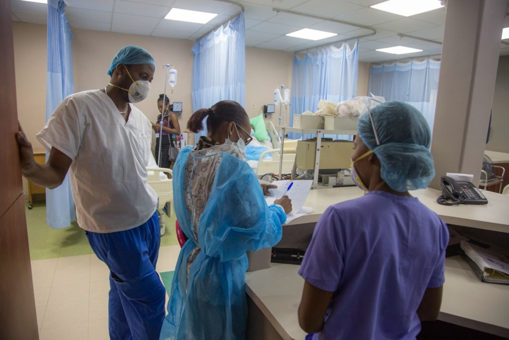 Haitian health care workers wear PPE